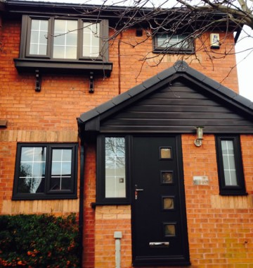 Black uPVC windows with matching front door and fascias