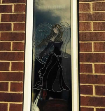 uPVC window with custom angel design glass