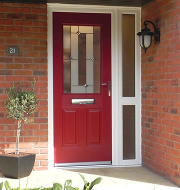 A composite door in ruby red