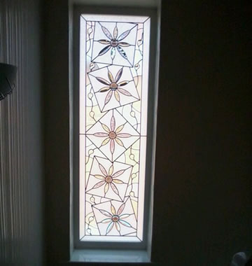 A double glazed window with decorative glass