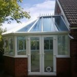White uPVC conservatory with self cleaning glass with a cat flap