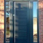 Grey composite entrance door installation