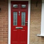 Red composite entrance door installation