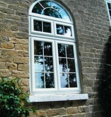 Casement windows with arched window above