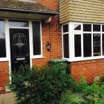 Bay windows and black composite entrance door