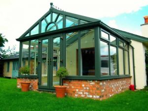 Gable conservatory in green uPVC- coloured conservatories