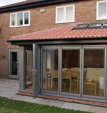 Grey aluminium bifolds with one door open