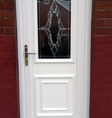 A white entrance door with glazed panel