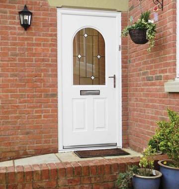White front door in composite materials with glazed panel