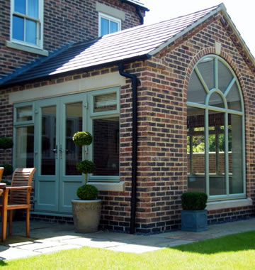 Orangery with Green upvc windows and doors