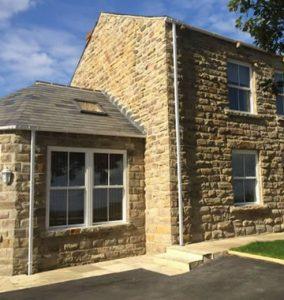 White uPVC sash windows on traditional home