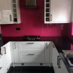 Pink splashbacks black sparkle glass work tops